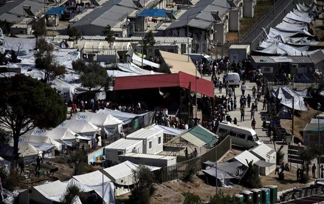 Фото: біженці (ekathimerini.com)