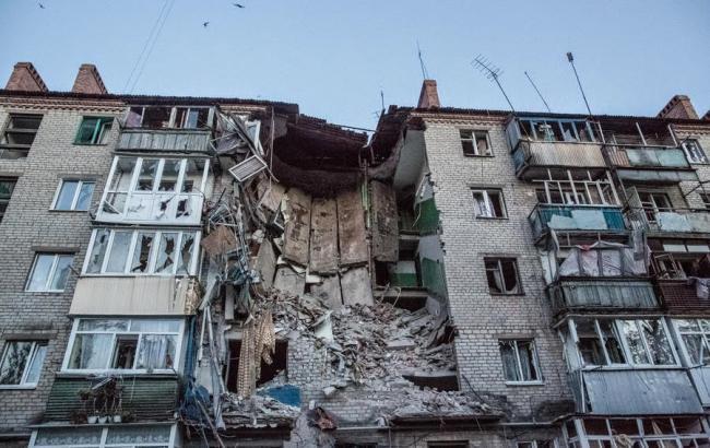 Фото: Разрушенный дом в Донецке (actualidad.rt.com)