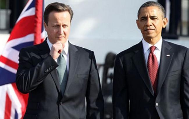 Обама и Кэмерон настаивают на сохранении жестких санкций против РФ