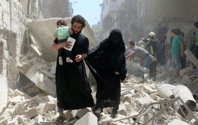 Фото: Меркель потрясена гуманитарной катастрофой в сирийском Алеппо
