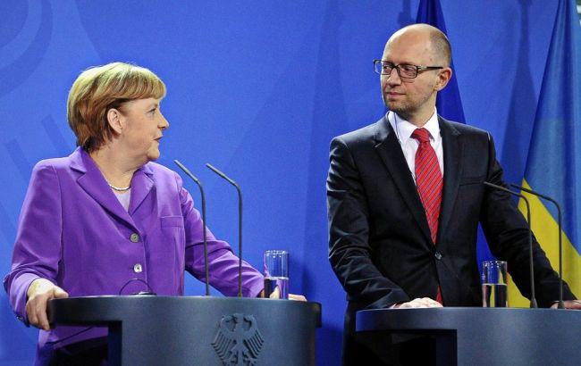 Фото: Меркель и Яценюк