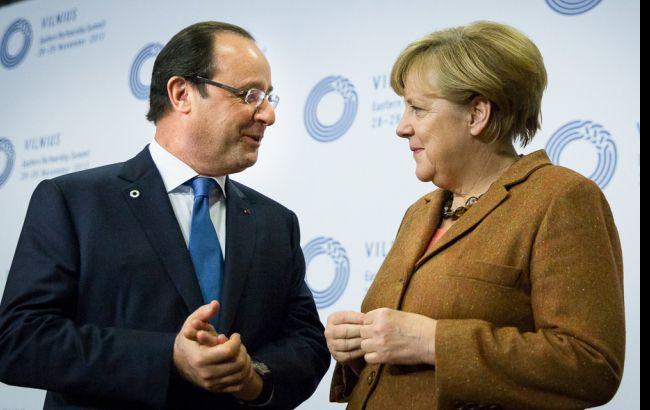 Фото: Франсуа Олланд і Ангела Меркель
