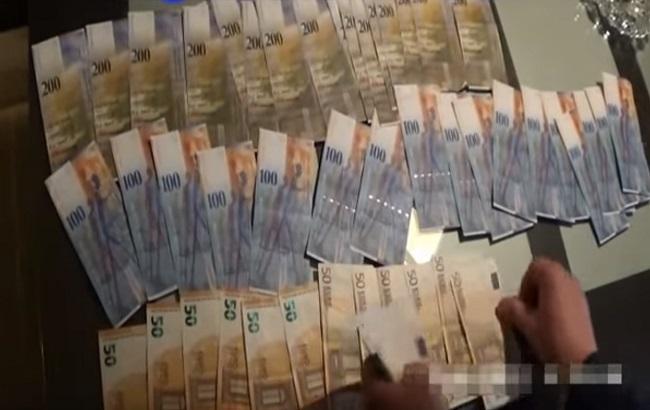 Фото: виявлена готівка (скріншот із відео Європолу)