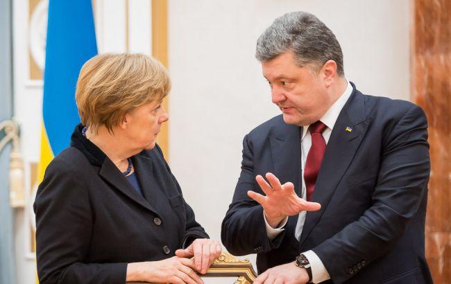 Меркель иПорошенко обсудят обстановку вДонбассе