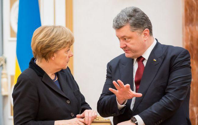 Порошенко і Меркель обговорили санкції проти РФ та підготовку до саміту НАТО
