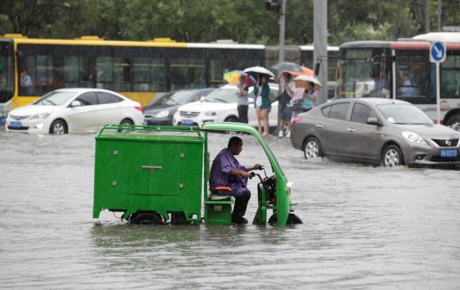 Фото: китайцы обвиняют власть в отсутствии предупреждений о наводнении