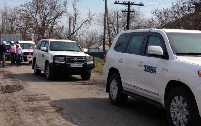 Фото: спостерігачі почули менше вибухів на Донбасі