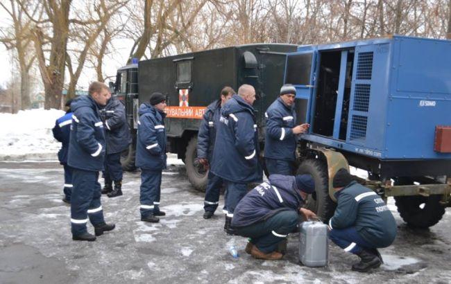 Фото: ремонтники в Авдеевке