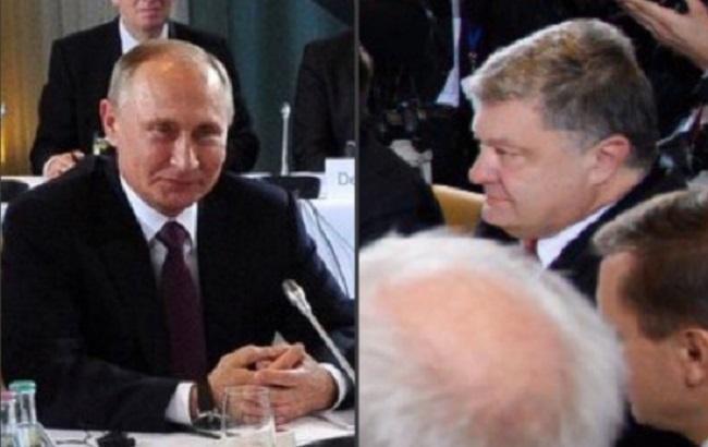 Фото: Порошенко і Путін на зустрічі в Берліні