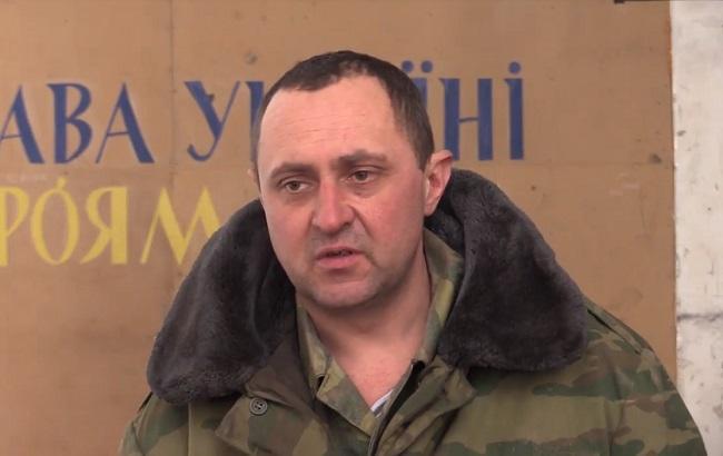 Фото: задержанный боевик (скриншот с видео пресс-центра штаба АТО)