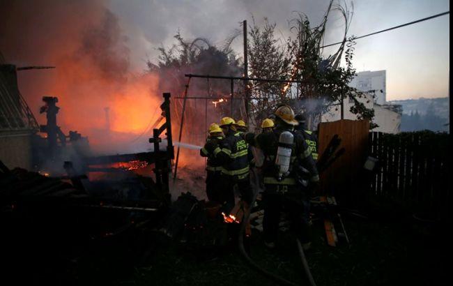 Фото: мешканці Хайфи повертаються в свої будинки після пожеж