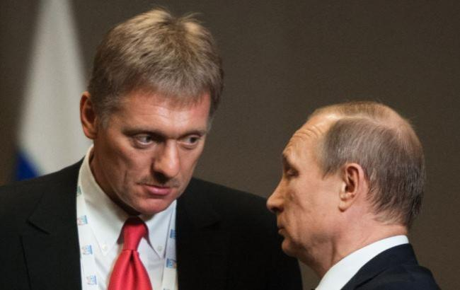 Фото: Дмитро Пєсков і Володимир Путін