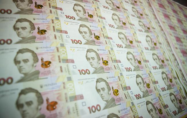 НБУ на 12 июля ослабил курс гривны до 26,22 грн/доллар