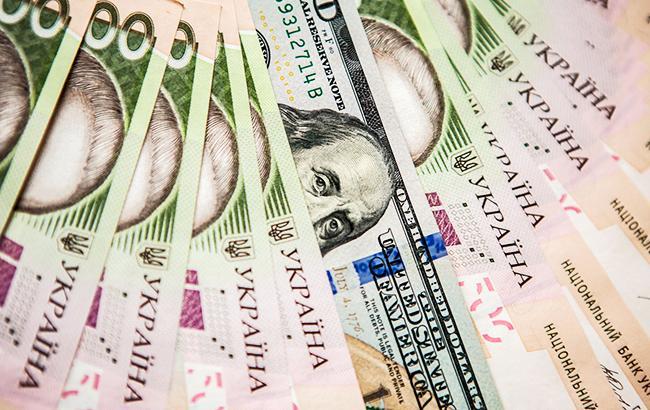 Фото: долар і гривні (прес-офіс НБУ)