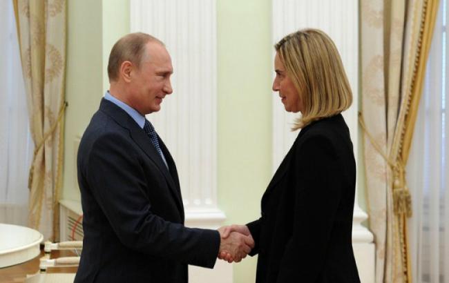 Фото: Федерика Могерини и Владимир Путин