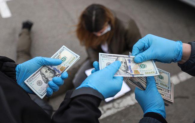 Поліцейського та іноземця із санкційного списку РНБО судитимуть за продаж фальшивої валюти