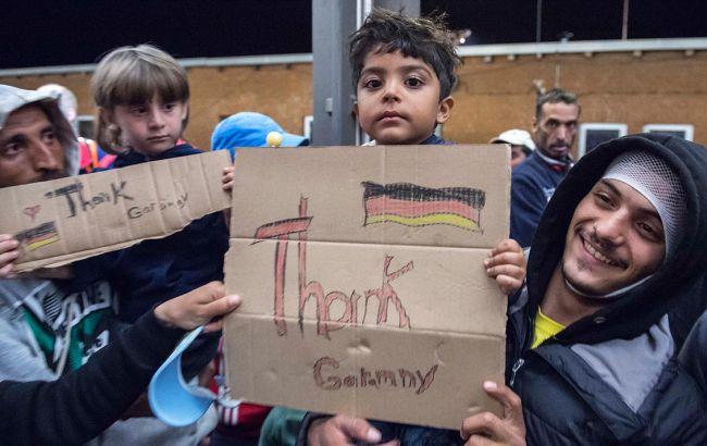 Фото: мигранты в Германии