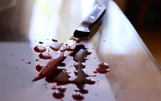 Фото: Нож в крови (РБК-Украина)