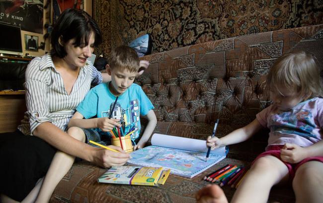 Фото: Кирилл с мамой и младшей сестрой (РБК-Украина)