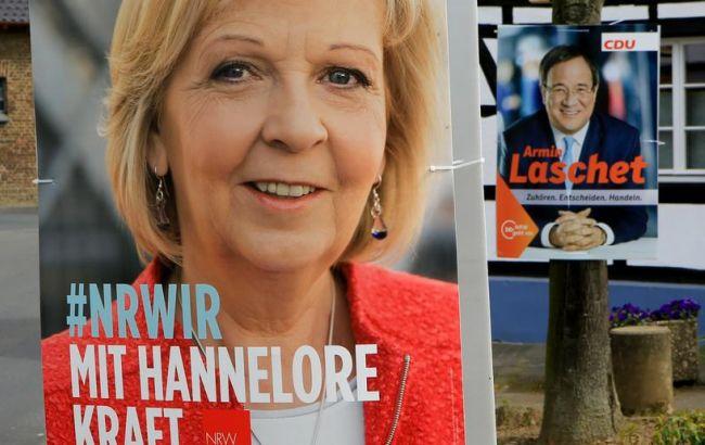 Вкрупнейшей земле ФРГ выборы выигрывает партия Меркель