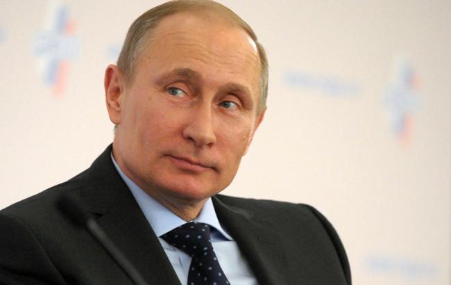 Фото: Путин и Меркель обсудили Украину