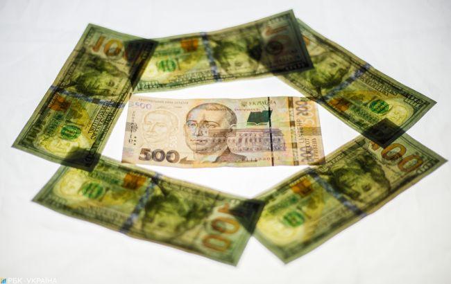 НБУ опустил официальный курс доллара ниже 28 гривен