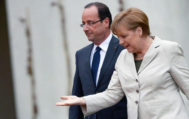 Меркель иОлланд непосетят экономический форум вДавосе