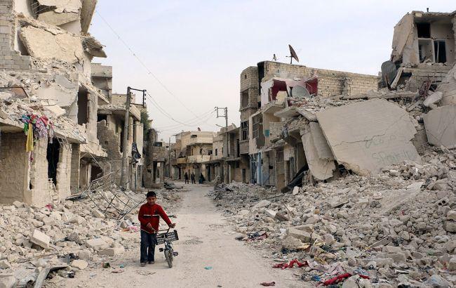 Фото: люди переходять в західну частину Алеппо, контрольовану урядом