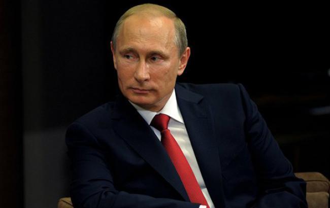 Путин уверен, что Порошенко настроен на мирное урегулирование конфликта на Донбассе