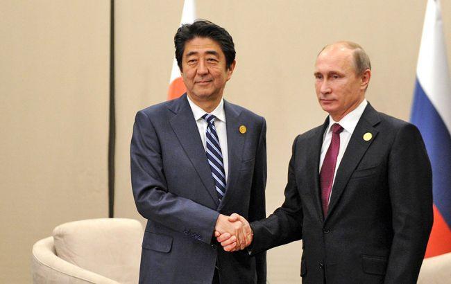 Фото: Синдзо Абэ и Владимир Путин