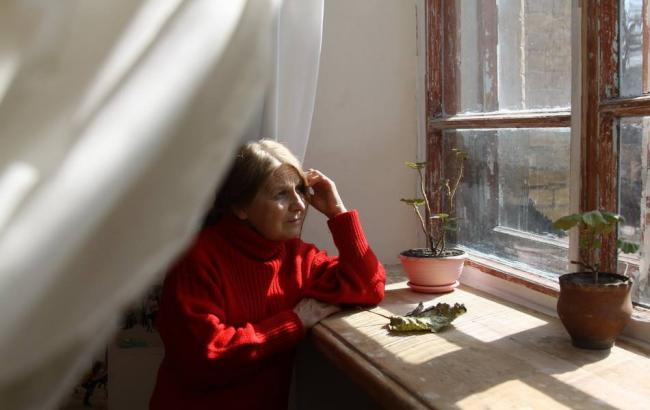 Фото: Женщина-переселенка (gazeta.ua © Мария Петренко)