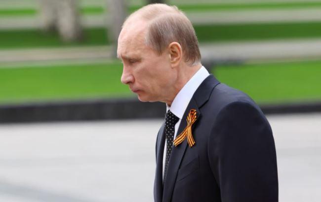 "Фото: ""Затравленное существо"" Путин (openrussia.org)"
