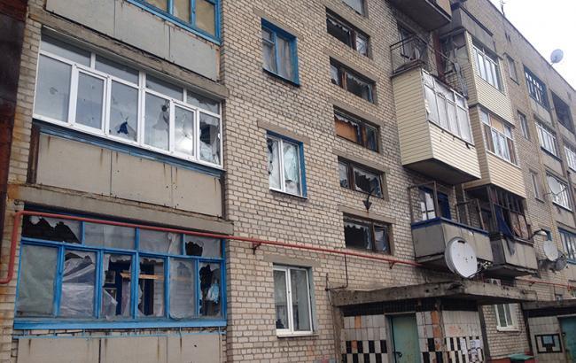 Фото: обстрелянный дом Марьинки (РБК-Украина)