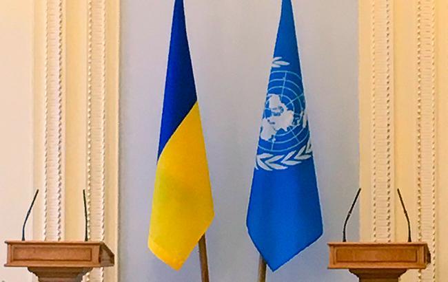Фото: флаги ООН и Украины (twitter.com/Верховная Рада)