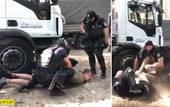 У Києві невідомі влаштували бійку з поліцією через альтанки (відео)