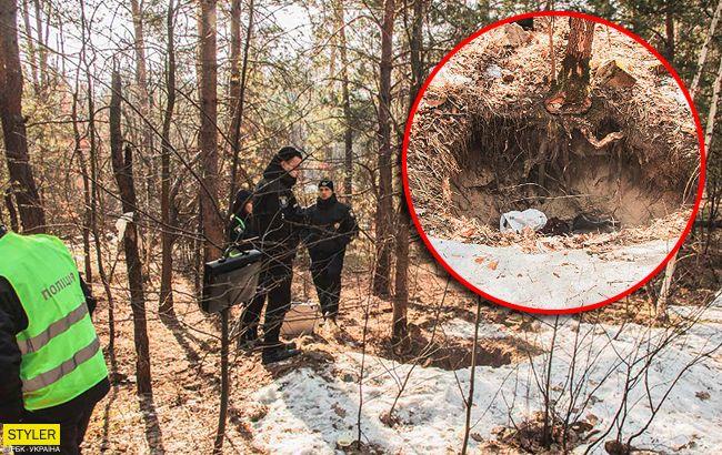 Замерзла в лесу: в Киеве нашли тело женщины в яме (видео)
