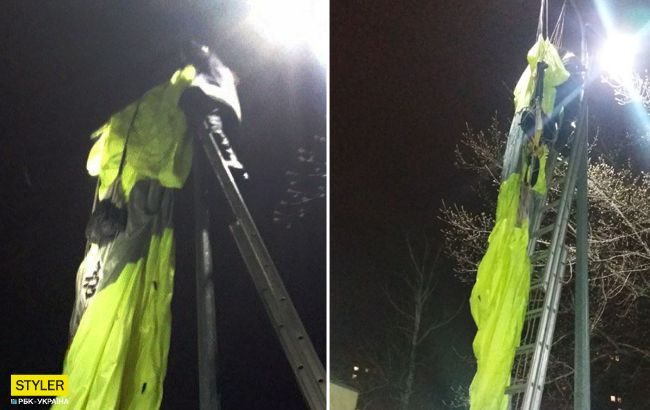 Рано зняли: у Києві чоловік стрибнув з багатоповерхівки і повис на стовпі (фото)