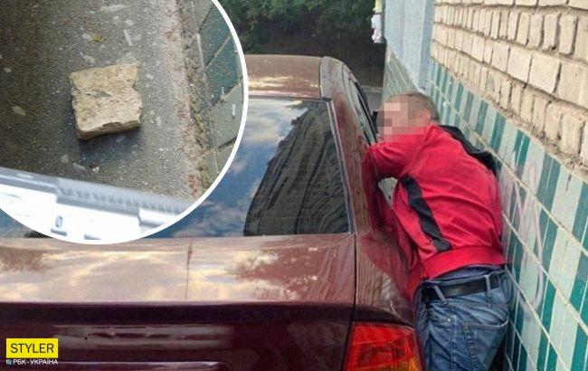 В Киеве дерзкий грабитель пытался обчистить авто, но его настигла карма (фото)