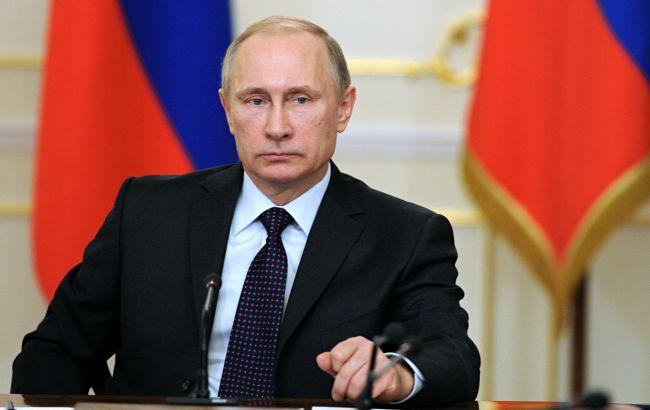 Фото: Путин заявил, что Порошенко предложил вооружить представителей ОБСЕ на Донбассе