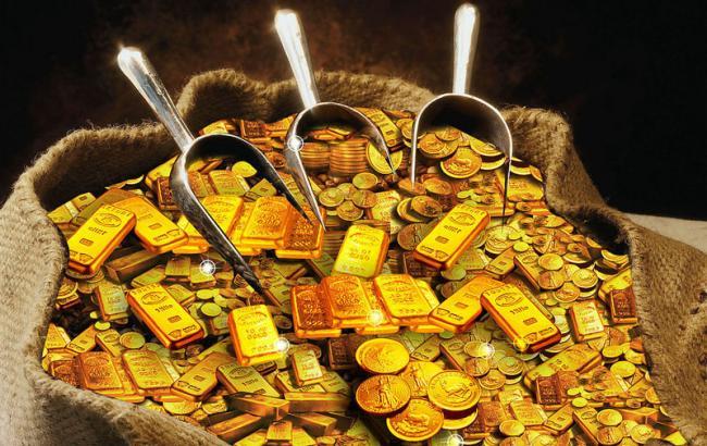 Фото: золото подешевелона 0,02%