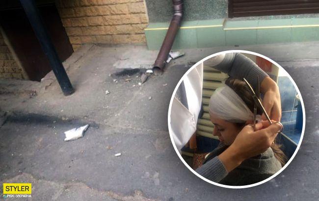 Потеряла сознание: в центре Одессы на женщину рухнул фасад дома (фото)