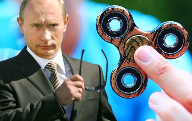 Путин и спиннер (Коллаж РБК-Украина)