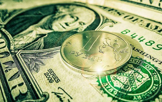 Биржевой курс доллара впервый раз сиюля позапрошлого года опустился ниже 60 руб.
