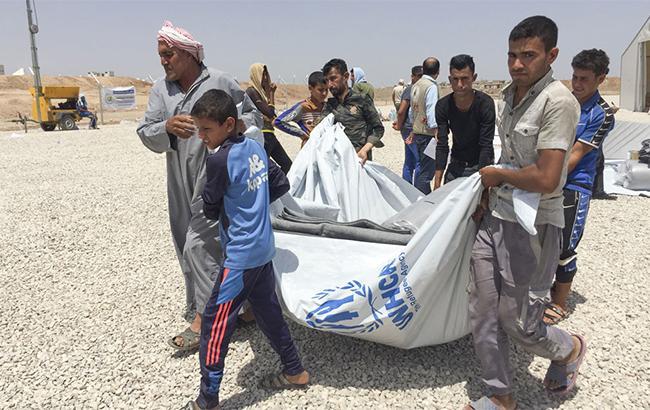 ВЛиване дотла сгорел лагерь беженцев изСирии