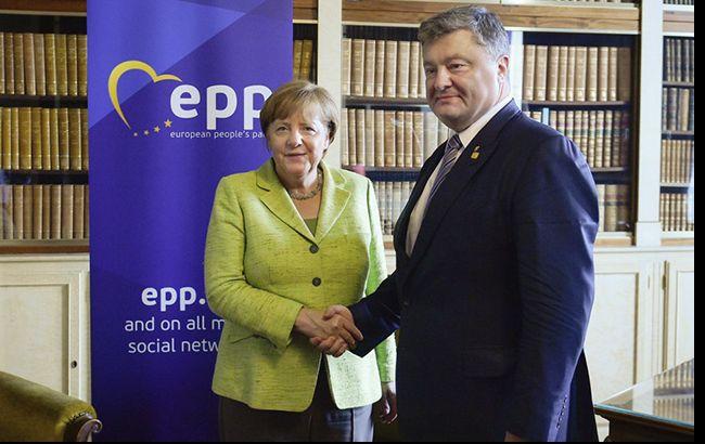 Порошенко и Меркель обсудили введение миротворческой миссии ООН на Донбасс