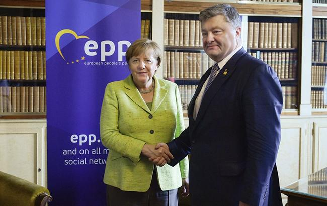 Фото: Порошенко і Меркель (president.gov.ua)