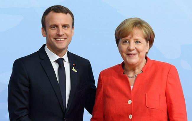 Фото: Эммануэль Макрон и Ангела Меркель (bundesregierung.de)