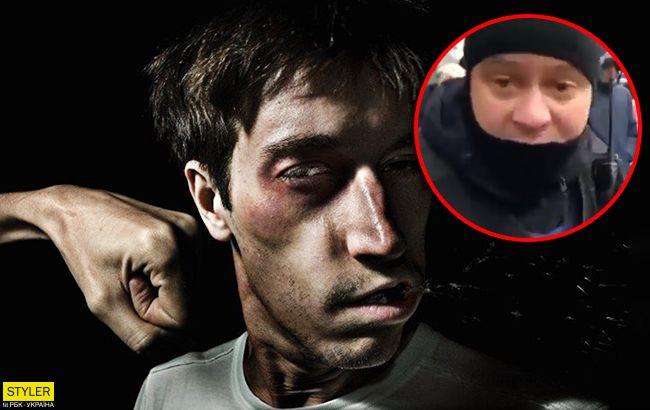 Полицейский ударил участника акции протеста в Киеве (видео)