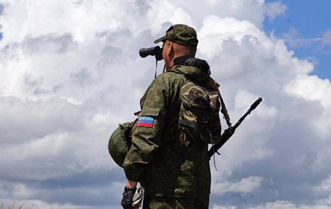 Фото: боевик на Донбассе (dnr-news.com)