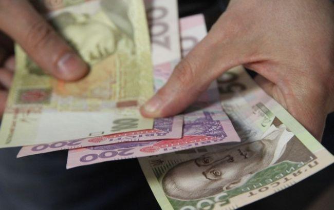 Фото: долг по зарплате в Украине немного вырос